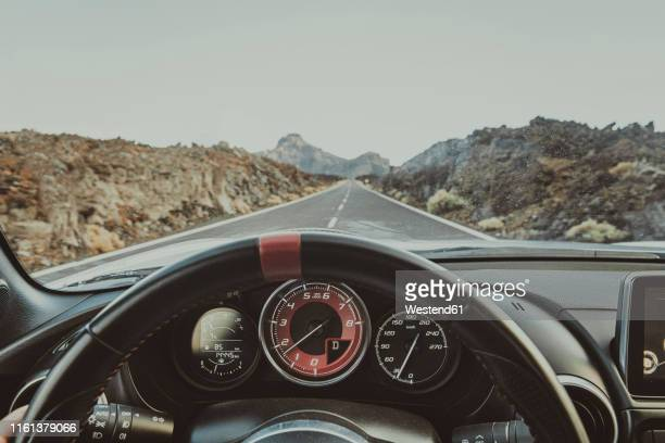 personal perspective in a car, road teide national park, tenerife, spain - steering wheel stock pictures, royalty-free photos & images