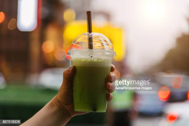 personal perspective in beijing cooling off with natural fruit milkshake during travel vacations - milkshake imagens e fotografias de stock