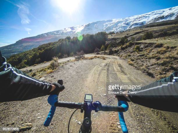 personal perspective of a cyclist on a trail in sierra nevada natural park, near trevélez (spain) - blickwinkel aufnahme stock-fotos und bilder