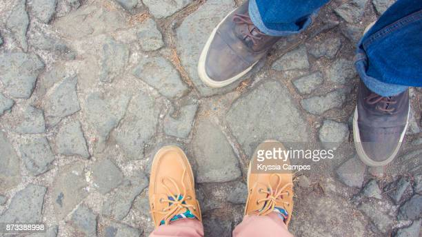 Personal Perspective of Couple Feet and Cobblestone