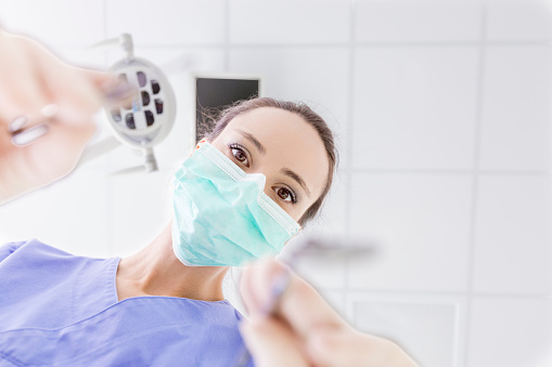 Personal perspective of female dentist with mask at work - gettyimageskorea