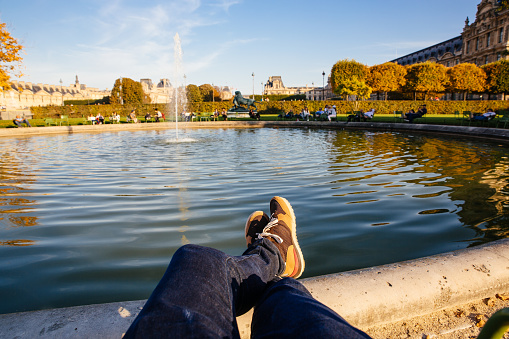 Personal perspective of man resting by the fountain in Tuileries Garden, Paris, France - gettyimageskorea