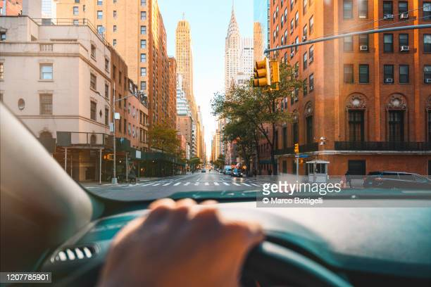 personal perspective of person driving in new york city - manhattan new york city stock pictures, royalty-free photos & images