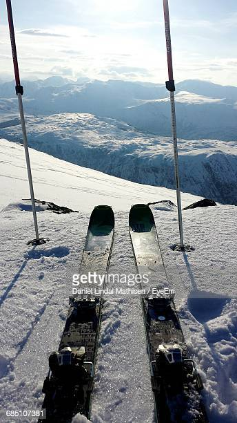 Personal Perspective Of Ski Equipment On Top Of Mountain