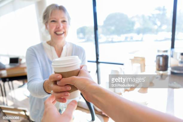 personal perspective of waitress assisting customer - giving stock photos and pictures