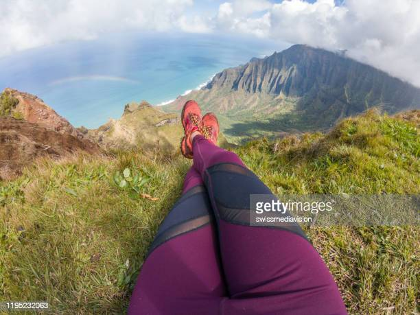 personal perspective of woman relaxing on top of valley in hawaii - media_in_honolulu,_hawaii stock pictures, royalty-free photos & images