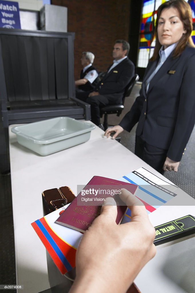 Personal Perspective Shot of a Person Holding a Passport Approaching a Customs Table in an Airport : Stock Photo