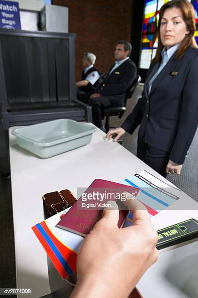 Personal Perspective Shot of a Person Holding a Passport Approaching a Customs Table in an Airport