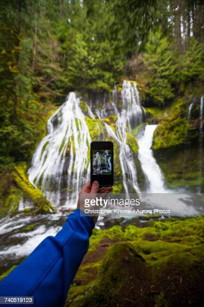 Personal perspective shot of person photographing Panther Creek Falls