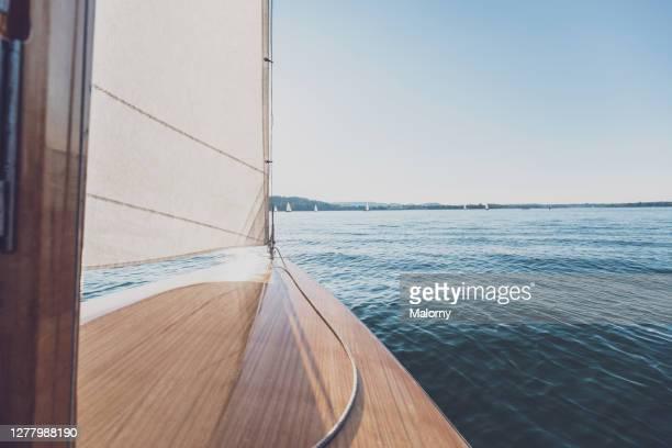 personal perspective: white sail or jib, sailboat and lake. - セールボート ストックフォトと画像