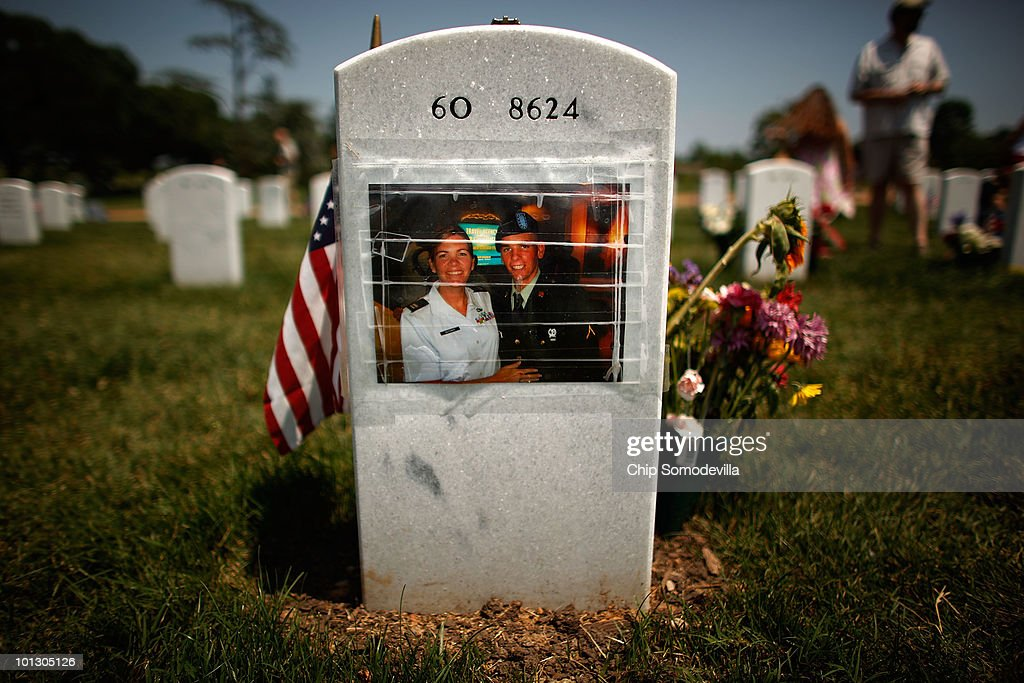 A personal photograph is taped to the back of U.S. Army Corporal Michael Pursel's headstone on Memorial Day in Section 60 of Arlington National Cemetery May 31, 2010 in Arlington, Virginia. Pursel was one of six soldiers killed by a roadside bomb in Baqubah, Iraq in 2007. Section 60 is where troopers killed in Iraq and Afghanistan are buried. This is the 142nd Memorial Day observance at the cemetery.