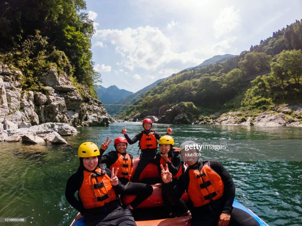 Personal point of view of a white water river rafting excursion : Stock Photo