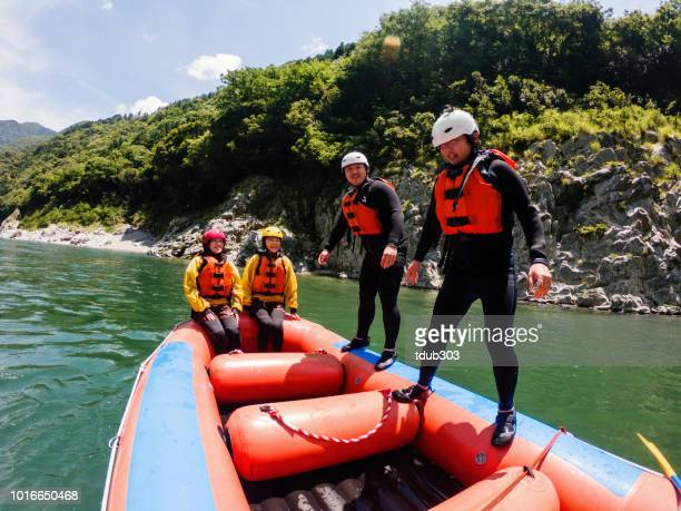 Personal point of view of people enjoying a white water river rafting tour