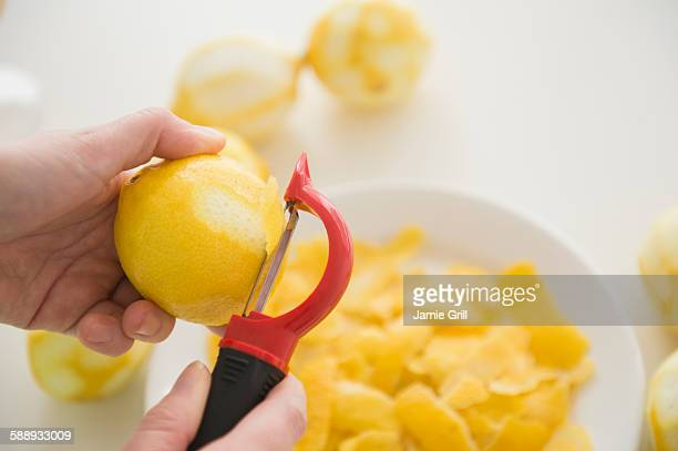 Personal point of view of person peeling lemons