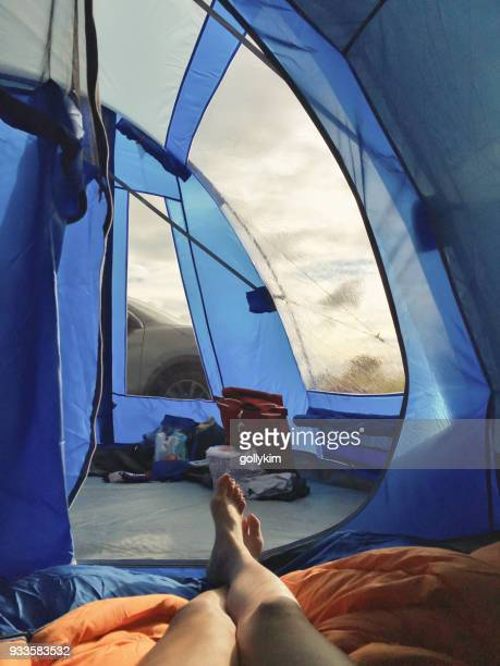 Personal point of view of woman lying in tent at the camp site in Cheddar, Somerset, England