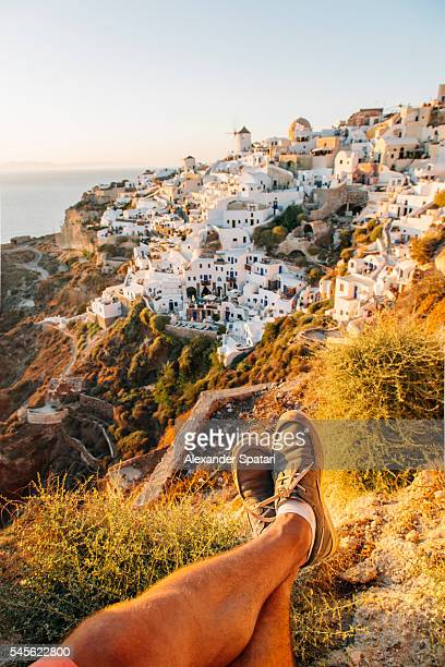 Personal point of view with feet in the frame, Oia village, Santorini island, Greece