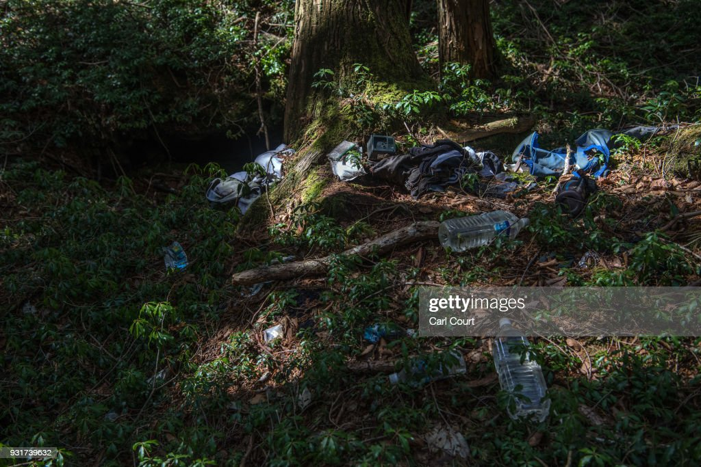 Personal possessions remain at the site of an apparent suicide in Aokigahara forest, on March 14, 2018 in Fujikawaguchiko, Japan. Aokigahara forest lies on the on the northwestern flank of Mount Fuji and in recent years has become known as one of the world's most prevalent suicide sites. The density of the forest is believed to be a contributing factor with people often tying string to trees to find their way back to a path in case they change their mind. In 2010, officials recorded more than 200 attempted suicides in the forest with attempts said to increase during the end of the Japanese fiscal year. In recent years, local officials have stopped publicising the numbers in an attempt to decrease Aokigahara's association with suicide.