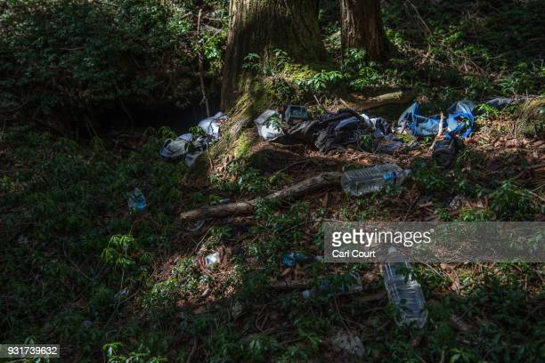 Personal possessions remain at the site of an apparent suicide in Aokigahara forest on March 14 2018 in Fujikawaguchiko Japan Aokigahara forest lies...
