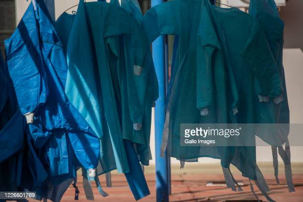 Personal Protective Equipment are hung next to tents dedicated to the treatment of possible COVID-19 coronavirus patients at the Tshwane District...