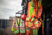 Personal protective equipments for sale on a shop: harness, reflective vests, yellow jackets, construction site helmets, as well as various other PPE devices
