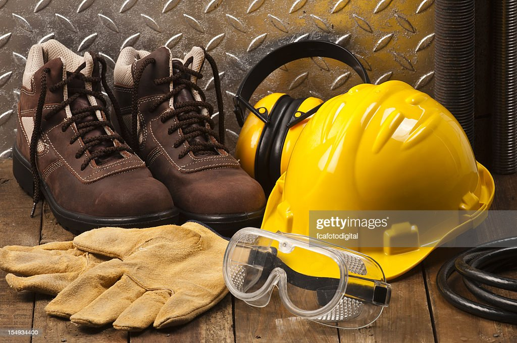 Personal protective workwear on the floor : Stock Photo