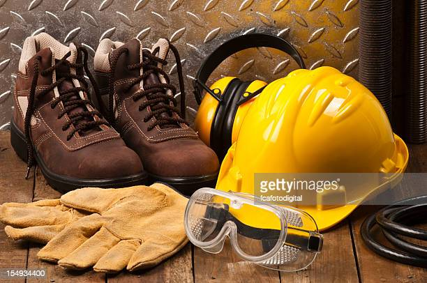 personal protective workwear on the floor - boot stock pictures, royalty-free photos & images
