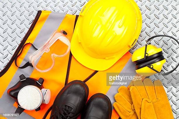 personal protective workwear shoot from above on diamondplate background - protective workwear stock pictures, royalty-free photos & images