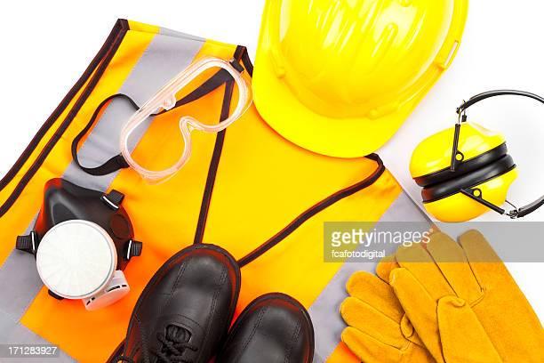 persönliche schutz- und arbeitskleidung aufnahmen von oben auf weißem hintergrund - sicherheitsausrüstung stock-fotos und bilder