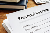 Personal records on a table. Privacy data.