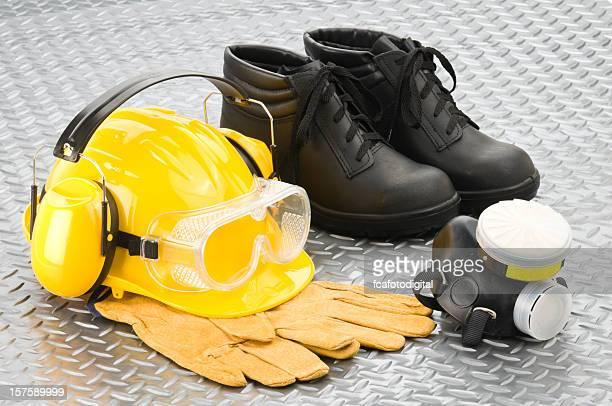 personal safety workwear on diamond plate background - beschermende werkkleding stockfoto's en -beelden