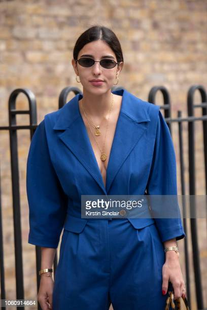 Personal Shopper and Digital Influencer Bettina Looney wears a Sea New York jumpsuit and Quay sunglasses during London Fashion Week September 2018 on...