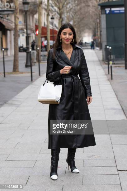 Personal shopper Bettina Looney wears a Nanushka trench Altuzarra bag and Manolo Blahnik boots on March 02 2019 in Paris France