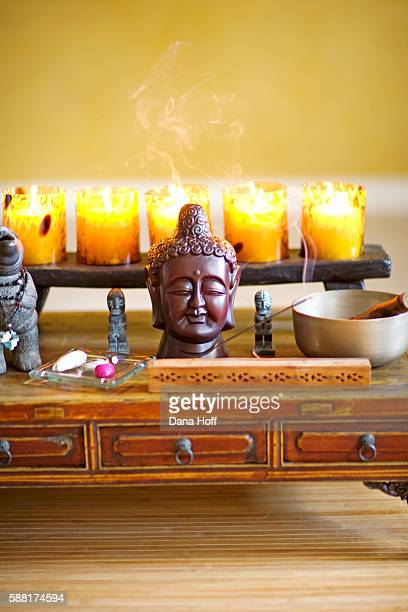 Personal shrine with candles, incense and statues