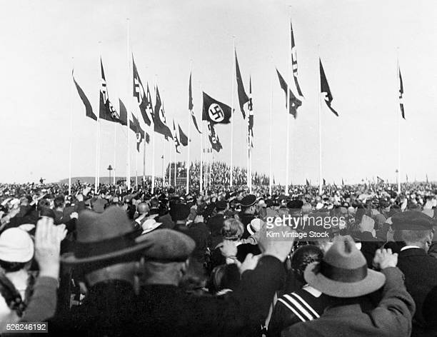 Personal snapshot of people saluting the Nazi flag at a rally in Germany during the 1930s.