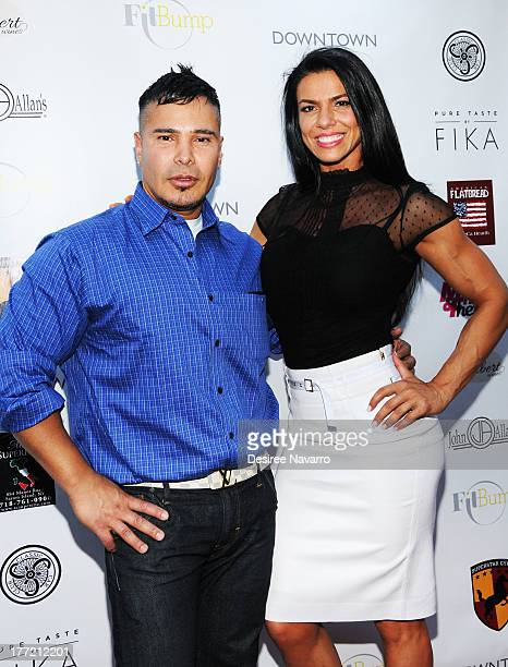 Personal trainer Alejandro Ferrari and Mona Muresan attend the Canali System US Debut at Superstar Gym on August 21 2013 in New York City