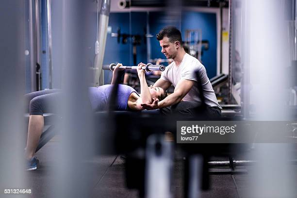 Personal trainer and woman at a gym