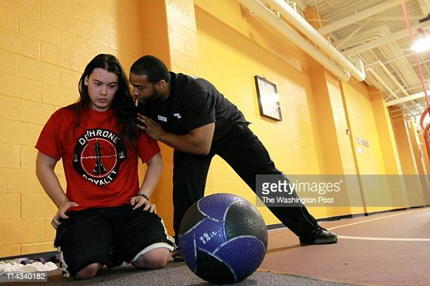 Personal trainer Charles Jenkins works with Ian Fung 17y at the YMCA 12196 Sunset Hills Rd Reston VA May 5 2011 Fung gets personal training 3x per...