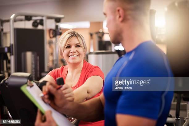 Personal trainer checking recent results. Debica, Poland