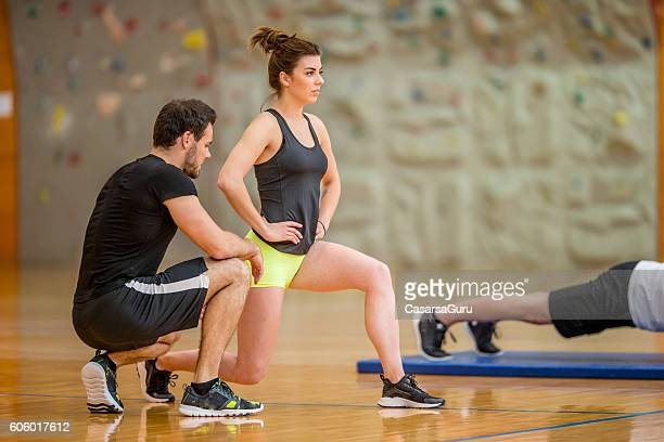 Personal Trainer Checking the Exercise Execution