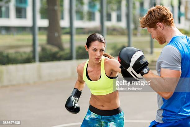 Personal Trainer doing boxercise with client