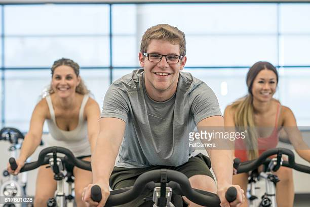 Personal Trainer Leading a Spin Class