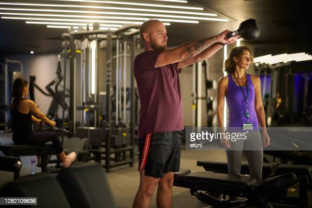 personal trainer - leisure facilities stock pictures, royalty-free photos & images