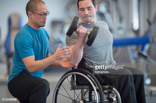 Personal Trainer Teaching a Man How to Lift Weights