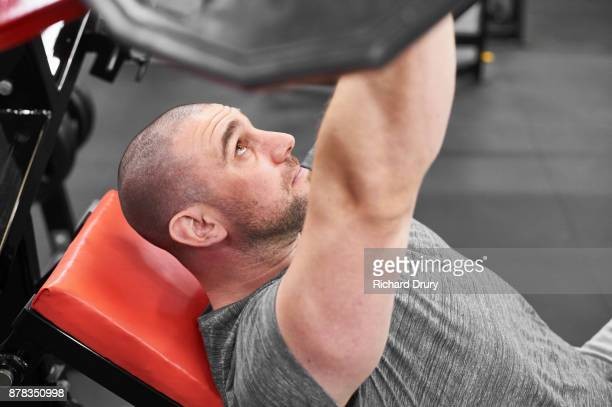 Personal trainer weightlifting in gym