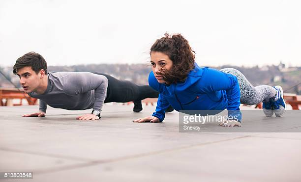 Personal trainer with his client