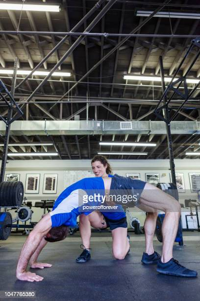 Personal Trainer Working with Client at a Fitness Gym