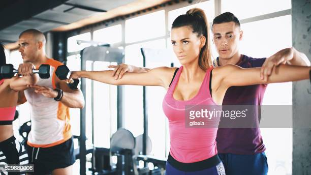 personal trainer workout. - pink pants stock pictures, royalty-free photos & images