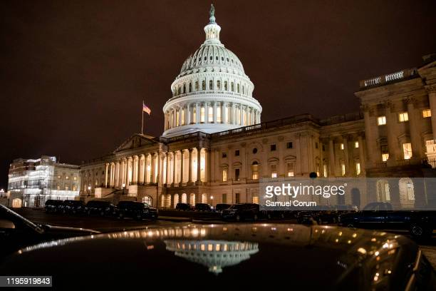 Personal vehicles fill the Senate side of the East Front of the US Capitol waiting to pick up Senators and other officials as soon as the Senate...