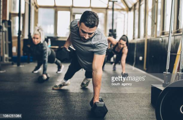 personal weight training in the gym - healthy lifestyle stock pictures, royalty-free photos & images