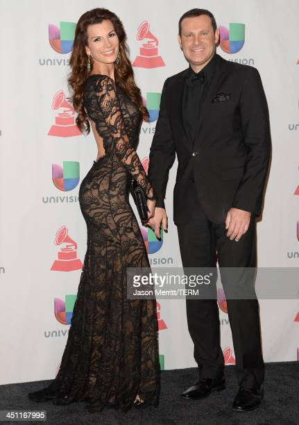 TV personalities Alan Tacher and Cristina Bernal pose in the press room at the 14th Annual Latin GRAMMY Awards held at the Mandalay Bay Events Center...